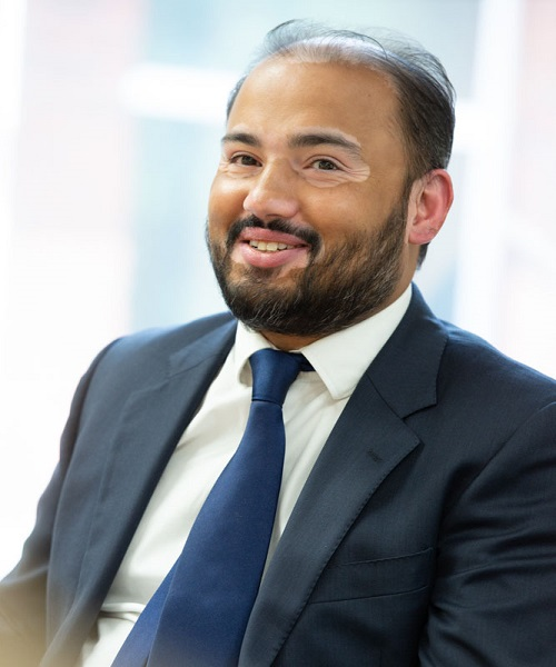 Khizerul Huda, Financial Controller, AutoProtect, man in suit and tie