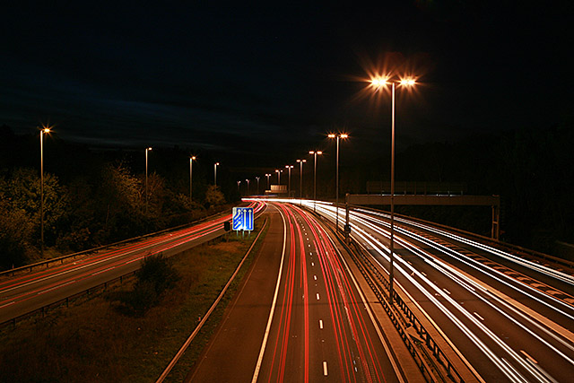 cars driving at night on motorway