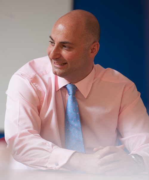 Salvatore Barno, AutoProtect Underwriting Manager, businessman in pink shirt and blue tie